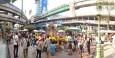 A crowd gathers around the Erawan shrine