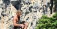 A climber dangles on Railay Beach